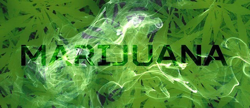 marijuana text on blurred cannabis leaves background