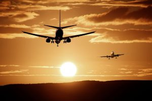 airplanes flying in the sunset
