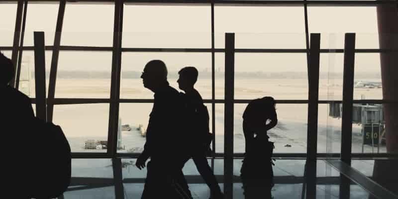 people walking in airport hallway