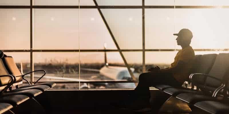 man waiting in airport at dawn