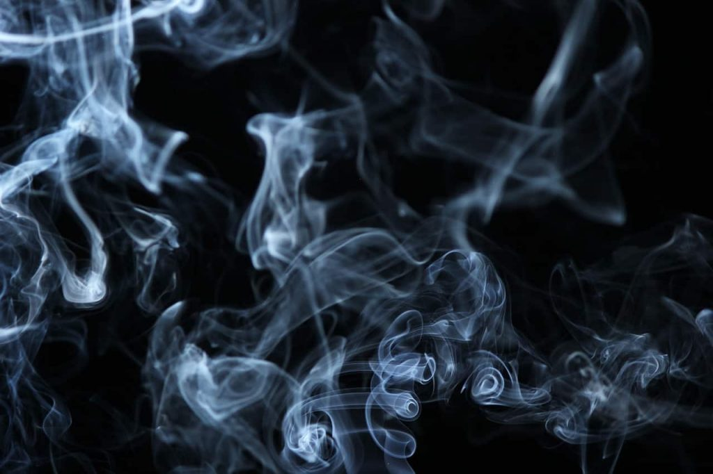 silver smoke on black background