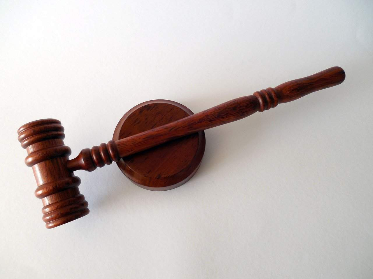 gavel placed on a white surface